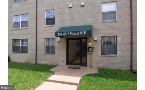 210 43rd Road NE #104 Photo 1