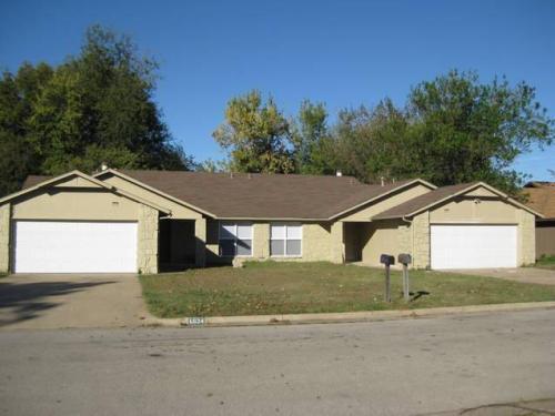 6634 S Utica Place Photo 1
