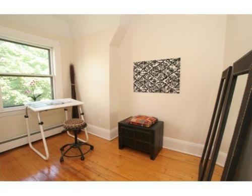Top floor open-concept living space. Photo 1