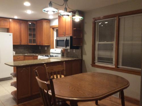 6131 S South Natoma Avenue #HOUSE Photo 1