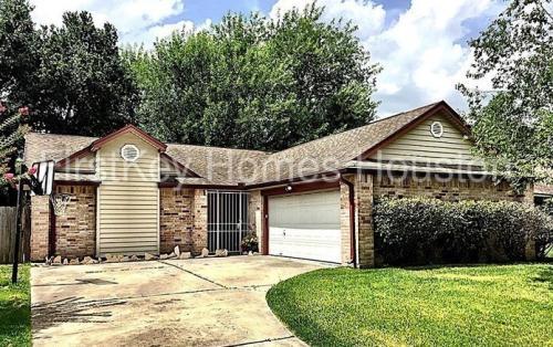 6027 Woodmancote Drive Photo 1