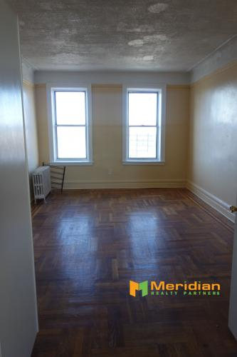 1878 Harrison Ave Apt 3F Photo 1